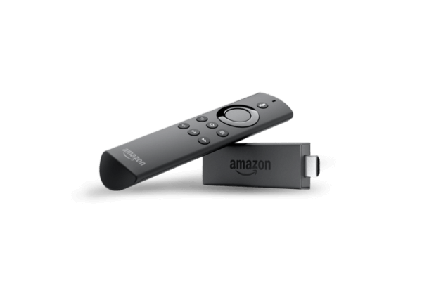 An Amazon Fire TV streaming strick alongside its remote control.