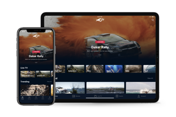 An iPhone displayed on top of an iPad with both showing Red Bull content from Red Bull TV.