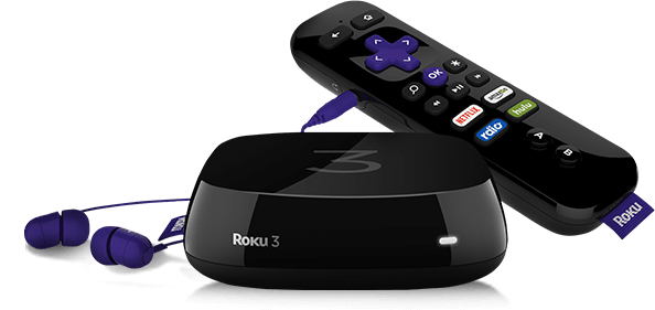 An Roku streaming device alongside its remote control and plugged in headphones.