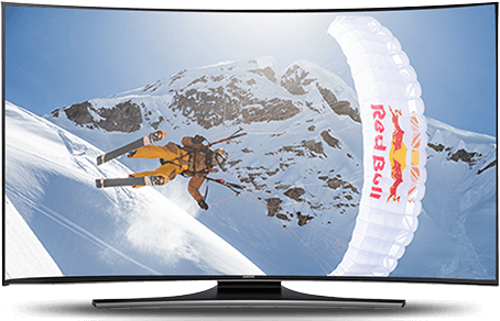 A Samsung Smart TV displaying a speedriding athlete featuring the Red Bull logo on his paraglider.