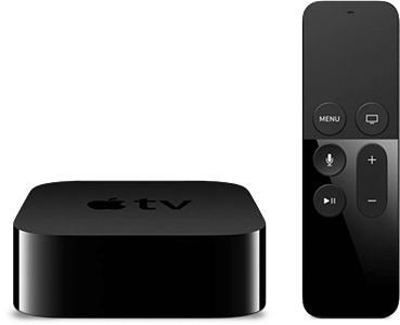 An Apple TV streaming device alongside its remote control.